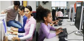 Kids using computers in school.